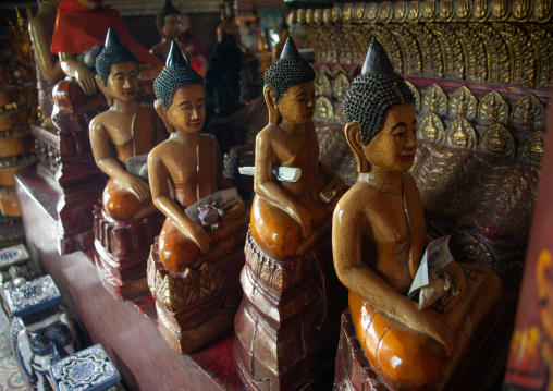 Statues with offerings in a temple, Phnom Penh province, Phnom Penh, Cambodia