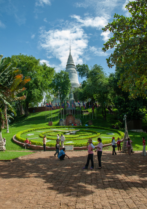 White stupa and large ornamental garden clock in the grounds of wat Phnom, Phnom Penh province, Phnom Penh, Cambodia