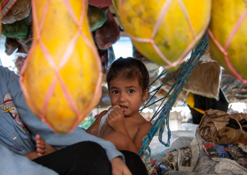 Cambodian girl on a hammock in a market, Phnom Penh province, Phnom Penh, Cambodia