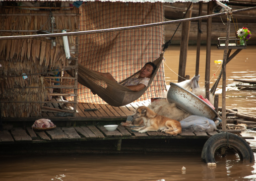 Cambodian man on a hammock in the floating village on Tonle Sap lake, Siem Reap Province, Chong Kneas, Cambodia