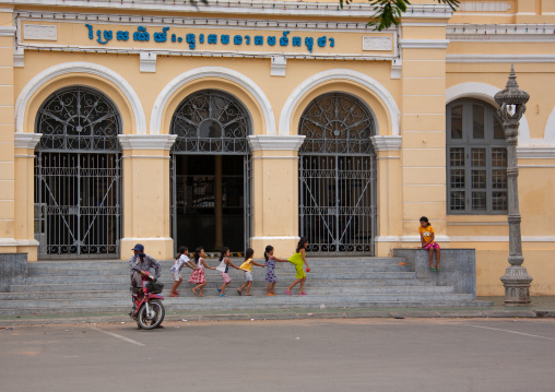 Cambodian children playing in front of the french-era post office, Phnom Penh province, Phnom Penh, Cambodia