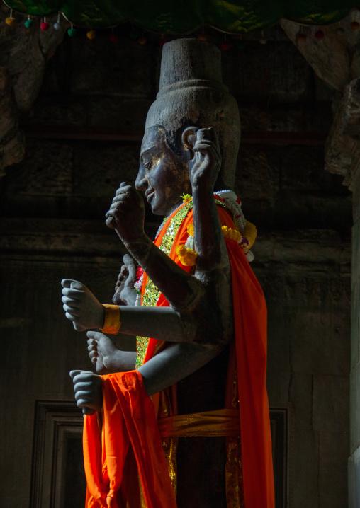 Statue of Vishnu the hindu god of protection inside the towers of Angkor wat, Siem Reap Province, Angkor, Cambodia