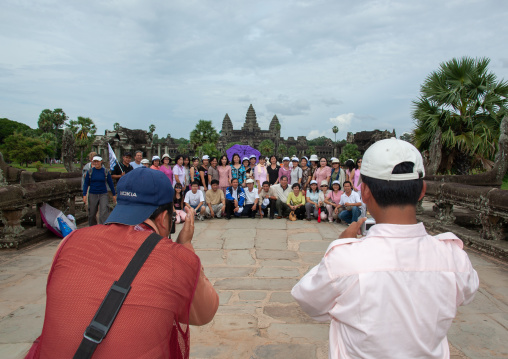 Tourists taking pictures in front of the Angkor wat, Siem Reap Province, Angkor, Cambodia