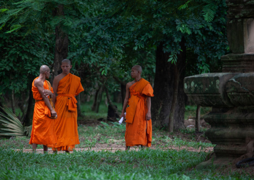 Monks in a garden in Angkor wat, Siem Reap Province, Angkor, Cambodia