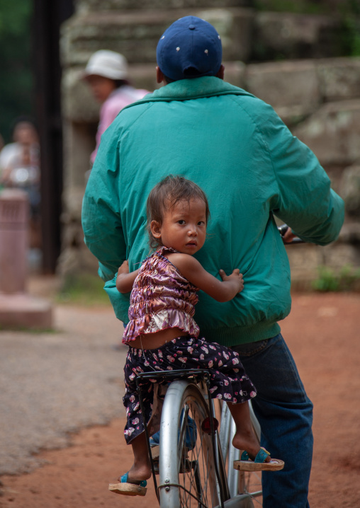 Father taking his son by bike, Siem Reap Province, Angkor, Cambodia