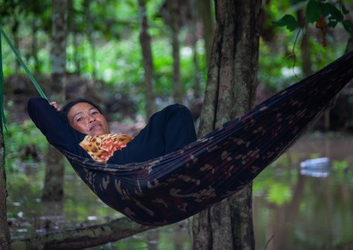 Cambodian woman resting in a hammock, Siem Reap Province, Angkor, Cambodia