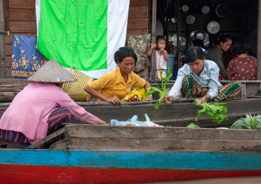 Women selling food on boats in the floating village on Tonle Sap lake, Siem Reap Province, Chong Kneas, Cambodia