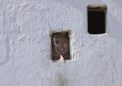 Woman Looking Thru A Little Window, Obock, Djibouti
