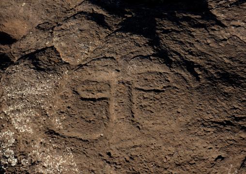 Human Face Petroglyph In Ahu Tongariki Area, Easter Island, Chile