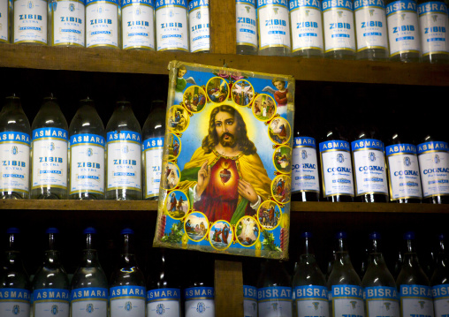 Jesus Poster In Front Of Zibib And Cognac Bottles, Central region, Asmara, Eritrea