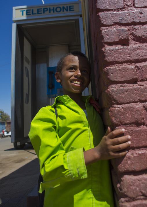Child In Front Of A Public Phone, Central region, Asmara, Eritrea