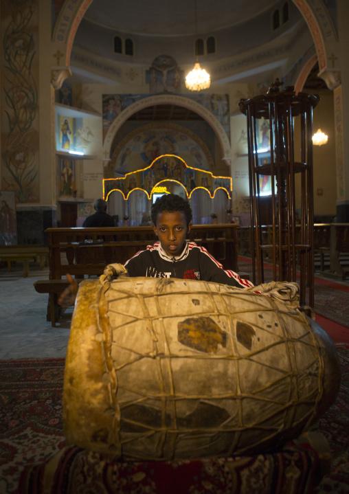 Boy Playing Drums In A Church, Central region, Asmara, Eritrea