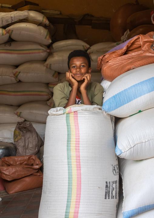 Eritrean boy in a warehouse full of grains bags, Central region, Asmara, Eritrea