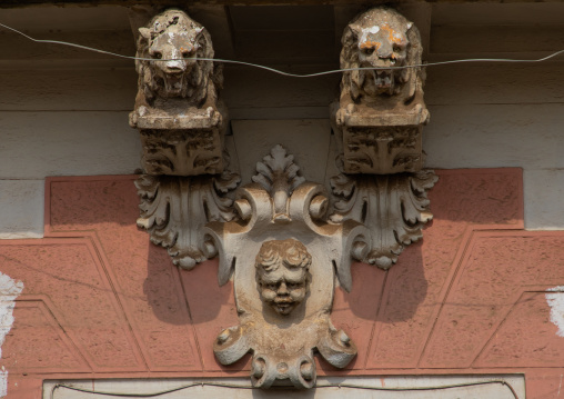 Lions and angel statues from the italian colonial era over a doorway, Central region, Asmara, Eritrea
