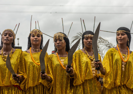 Afar tribe women dancing with a jile knife during expo festival, Central region, Asmara, Eritrea