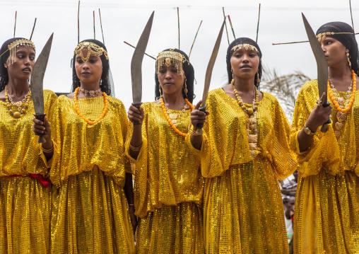 Afar tribe women dancing with a jile knife during expo festival, Central region, Asmara, Eritrea