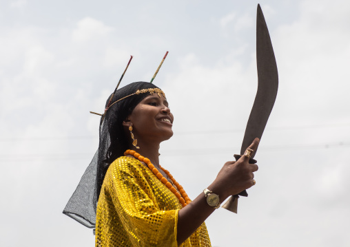 Afar tribe woman dancing with a jile knife during expo festival, Central region, Asmara, Eritrea