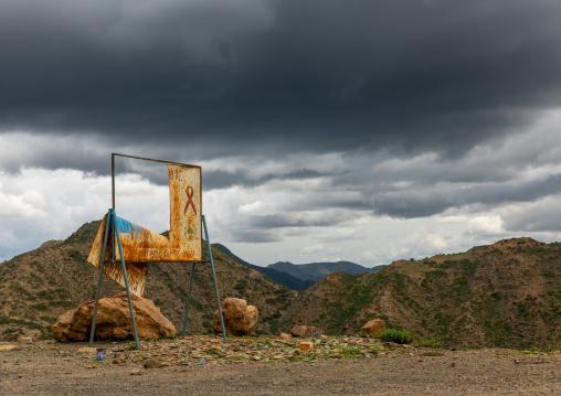 Old hiv billboard against storm clouds in the highlands, Central region, Asmara, Eritrea