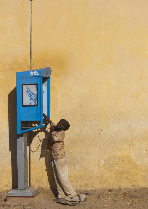 Child Using A Public Phone, Anseba, Keren, Eritrea