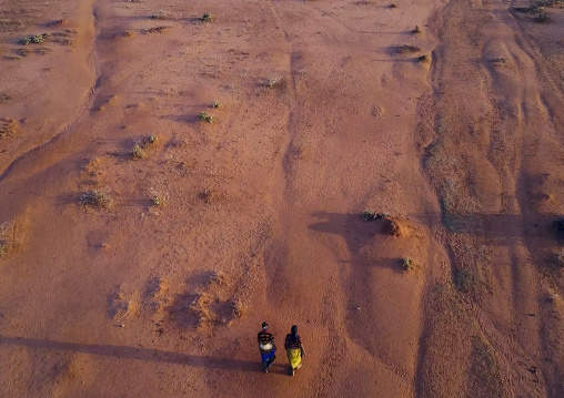 Aerial view of two women waliking in an arid area, Oromia, Yabelo, Ethiopia