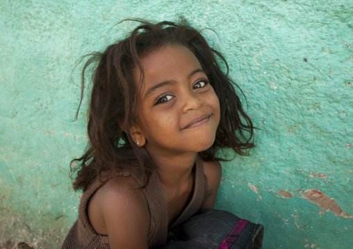 Portrait Of A Smiling Kid With Wild Hair In Harar, Ethiopia