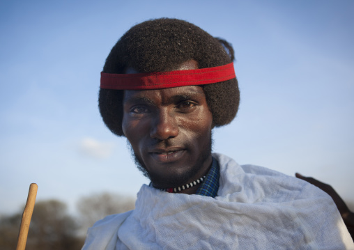 Portrait Of A Smiling Karrayyu Tribe Men With Gunfura Hairstyle And Red Hairband During Gadaaa Ceremony, Metahara, Ethiopia