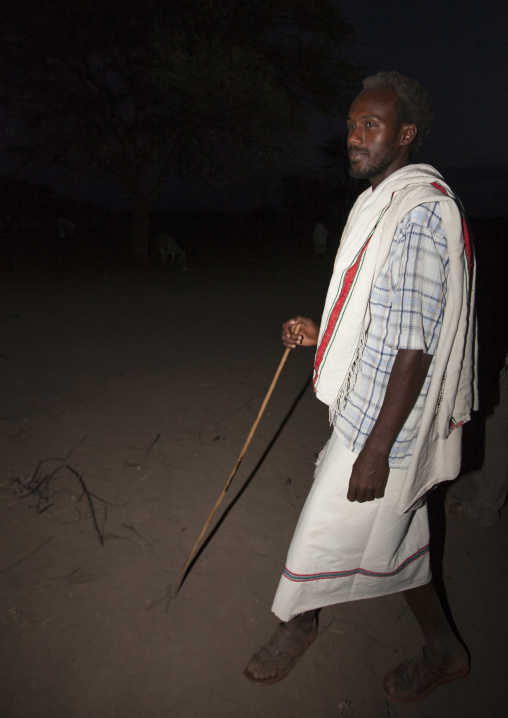Night Shot Of A Karrayyu Tribe Man In Traditional Clothes During Gadaaa Ceremony At Night, Metahara, Ethiopia