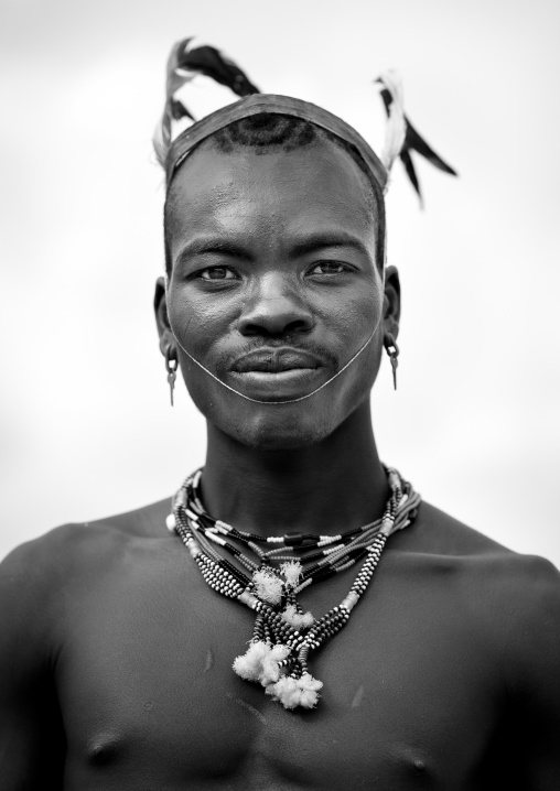 Portrait Of Bare Chest And Feather Headgear Banna Whipper Man Omo Valley Ethiopia