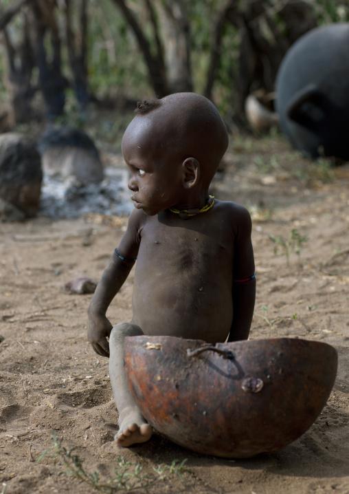 Banna Baby Boy Sitting On The Floor Near Half Calabash Ethiopia