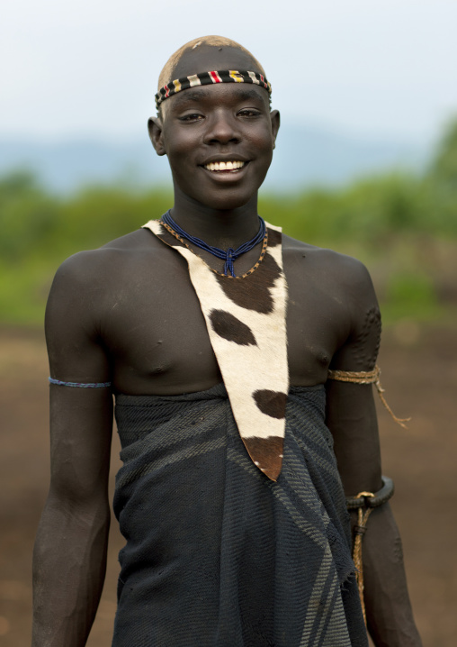 Cute Fashionable Bodi Boy With Traditional Loincloth Smile Looking At Camera Omo Valley Ethiopia