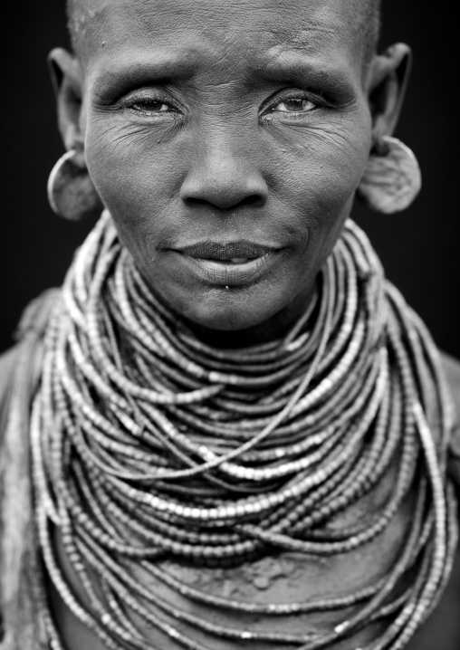 Portrait Of A Karo Woman With Beaded Necklaces And Earrings Ethiopia