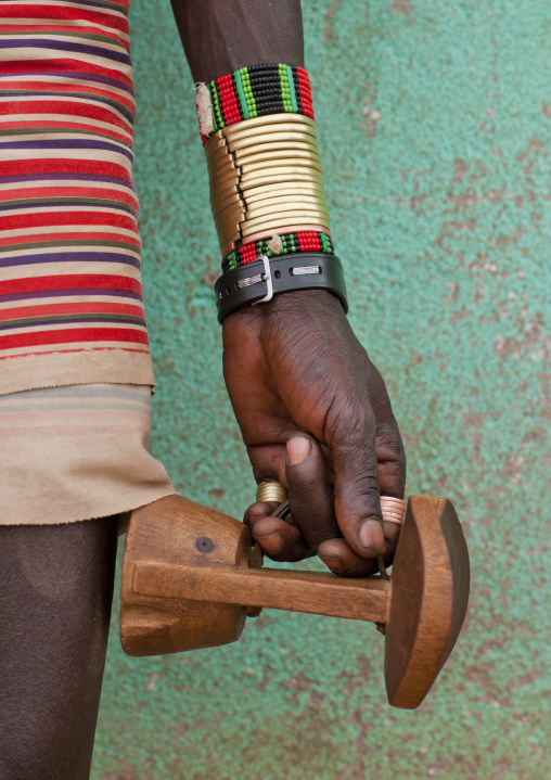 Detail Of Hamer Man Hand With Bracelets Carrying Wooden Carved Headrest Omo Valley Ethiopia