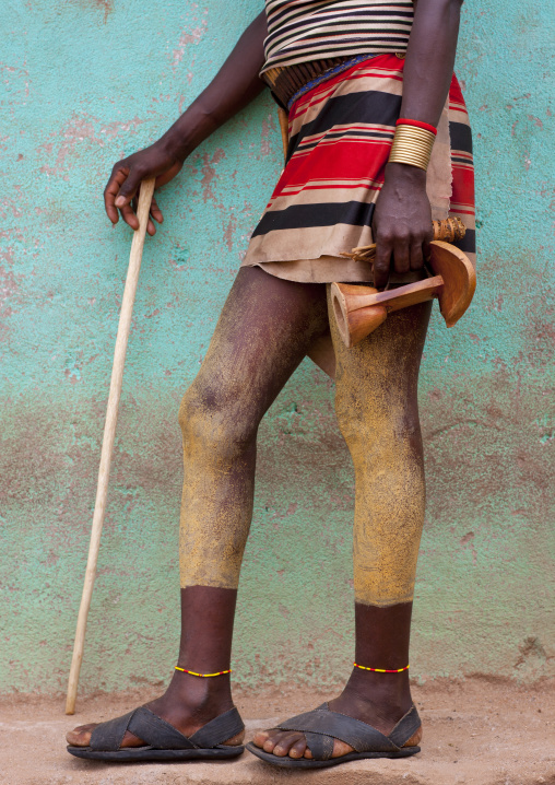 Legs Of Hamer Spread With Clay, Carrying Wood Stick And Headrest Omo Valley Ethiopia