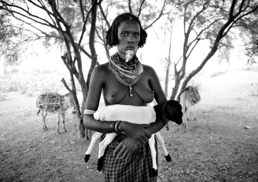 Beautiful Naked Breasts Dassanech Woman With Beaded Necklaces And Black And White Baby Goats In Arms Omorate Ethiopia