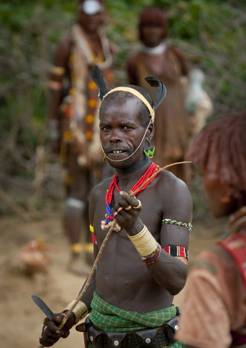 Whipper In Front Of The Hamer Woman He Is About To Flog Celebrating Bull Jumping Ceremony Ethiopia