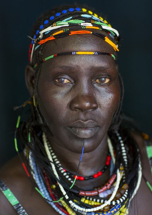 Woman From Anuak Tribe In Traditional Clothing, Gambela, Ethiopia