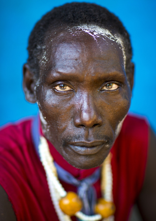 Man From Anuak Tribe In Traditional Clothing Wearing An Amber Necklace, Gambela, Ethiopia