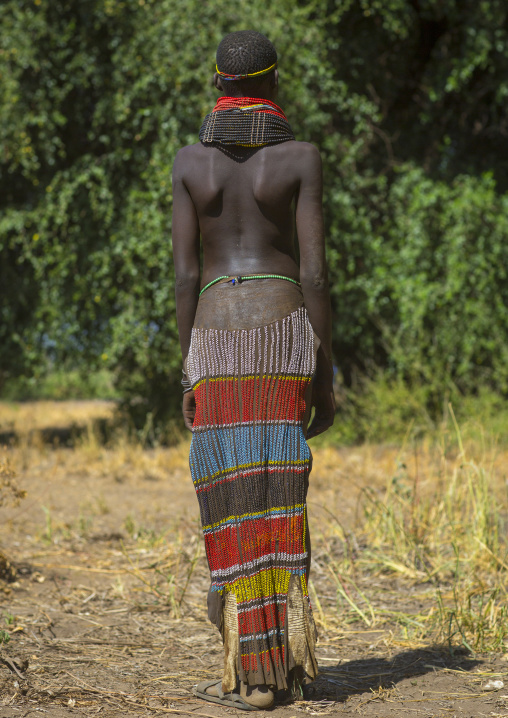 Portrait Of A Nyangatom Tribe Girl With Traditional Beaded Skirt, Omo Valley, Kangate, Ethiopia