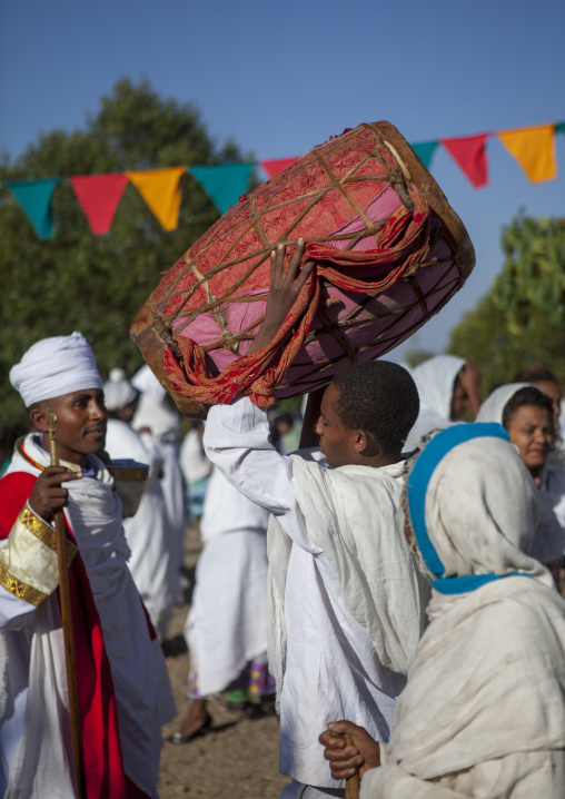 Orthodox Pilgrim Holding A Drum At Timkat Festival, Lalibela, Ethiopia