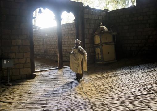 Priest Inside Yemrehana Krestos Rock Church, Lalibela, Ethiopia