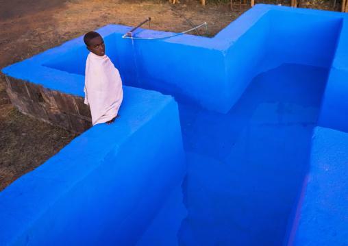 Orthodox Pilgrim In Front Of The Pool At Timkat Festival, Lalibela, Ethiopia