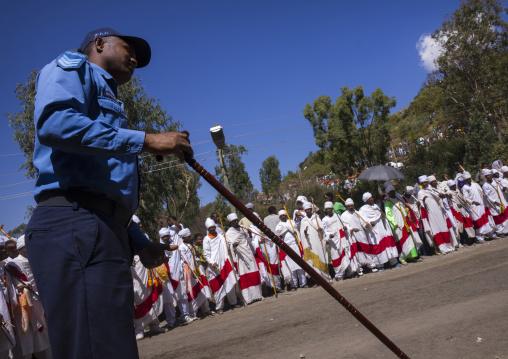 Ethiopian Policeman In Front Of The Priests Celebrating Timkat Epiphany Festival, Lalibela, Ethiopia