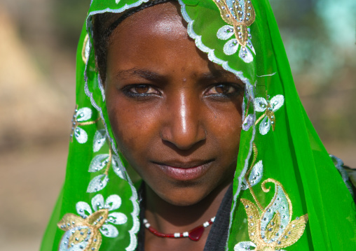 Portrait of an oromo woman with maria theresa thalers necklace, Oromo, Sambate, Ethiopia