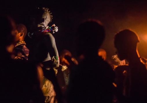 Hamer tribe teenage boys dancing at night, Omo valley, Turmi, Ethiopia