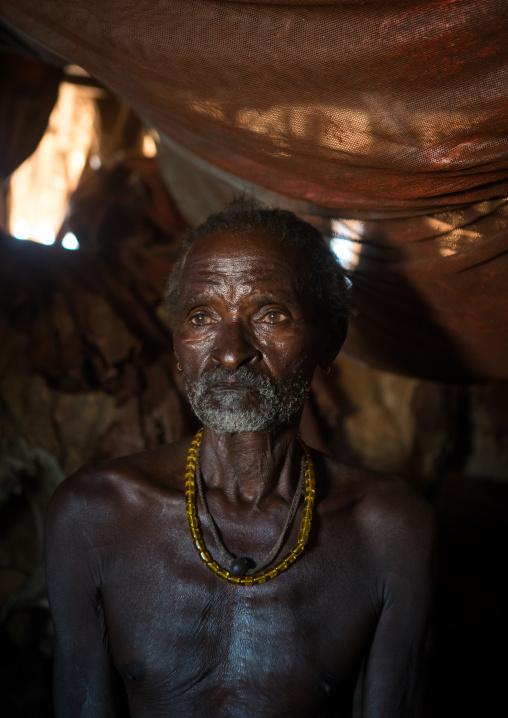 Old hamer tribe man in his hut, Omo valley, Turmi, Ethiopia