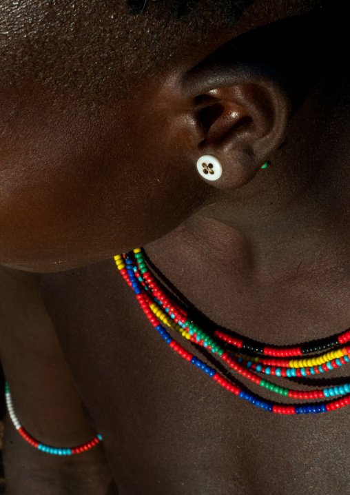 Hamer tribe girl with a button used as earring, Omo valley, Turmi, Ethiopia