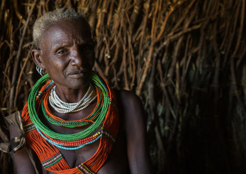 Toposa tribe woman in her hut, Omo valley, Kangate, Ethiopia