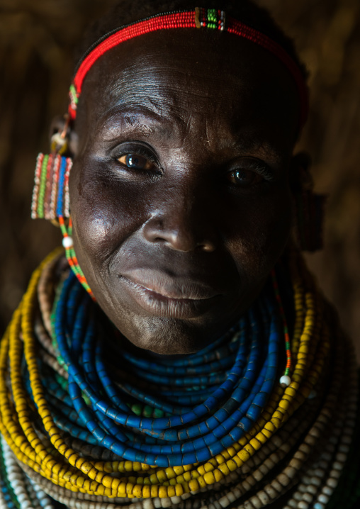 Nyangatom tribe woman with piles of beads, Omo valley, Kangate, Ethiopia