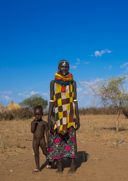 Murle tribe woman with a beaded apron and her child, Omo valley, Kangate, Ethiopia