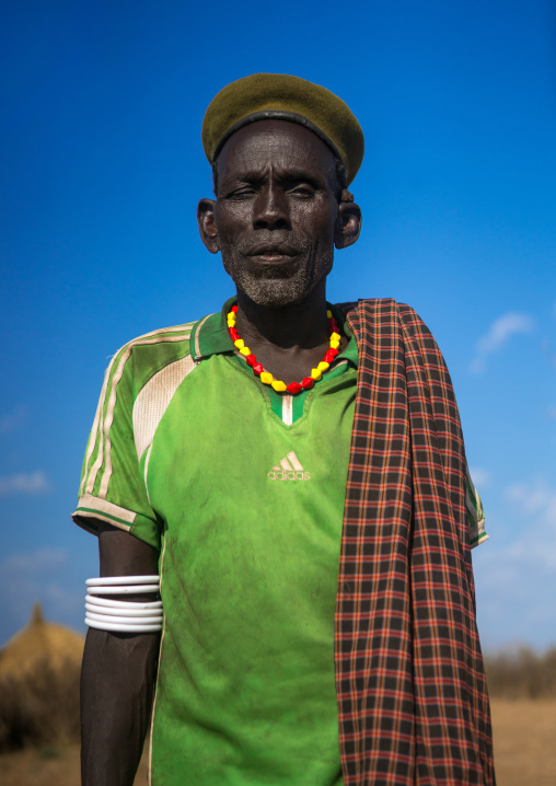 Murle tribe old man with a beret, Omo valley, Kangate, Ethiopia